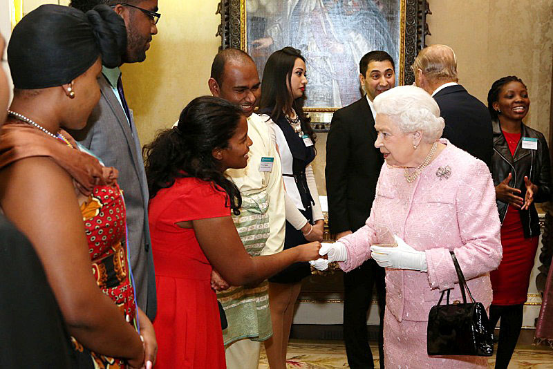 Honour: Angelique meets the Queen at Buckingham Palace