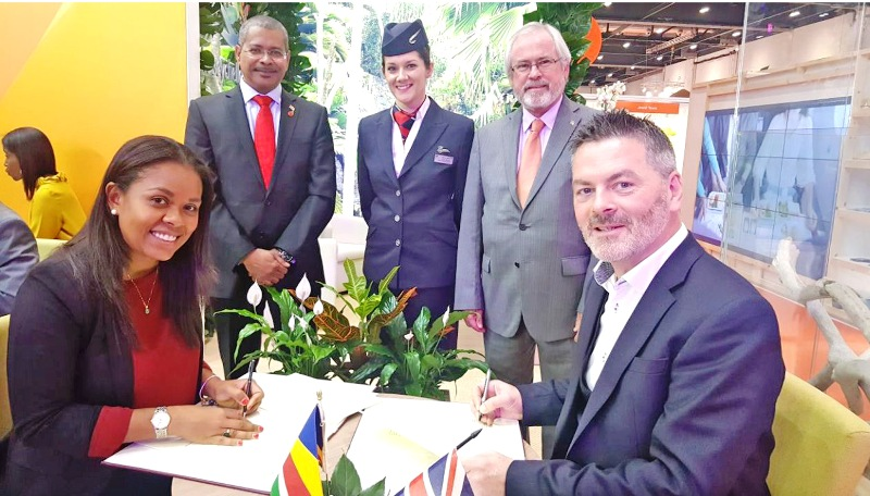 It's a deal: Tourist chief Sherin Francis, left, signs the agreement with BA's Chris Rankin watched by Derick Ally, High Commissioner to the United Kingdom, and Minister for Tourism Maurice Loustau-Lalanne