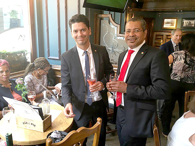 Message: High Commissioner Derick Ally with Terry Romain
