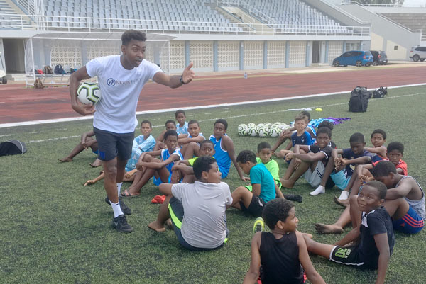 Top coach: Kevin helps youngsters in Seychelles attending a Kevin Betsy Foundation session