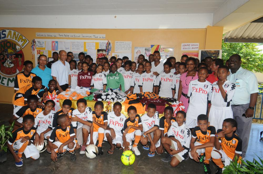 All together: Kevin (centre back) with youngsters at the Belony School and members of the Seychelles Football Federation