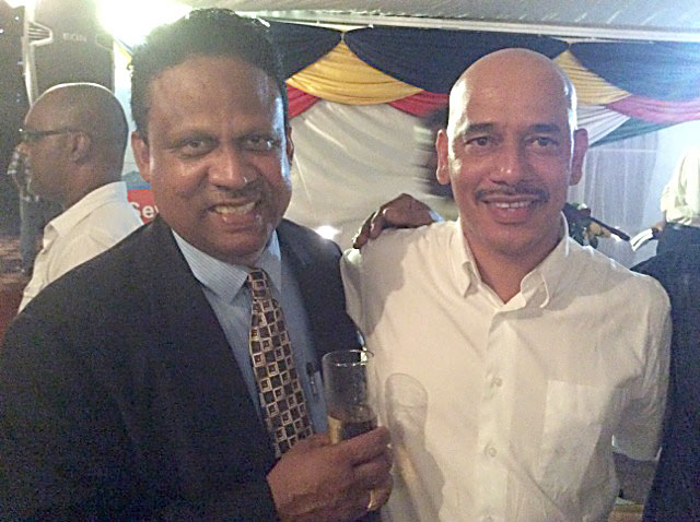 Friends of Sir James: Nichol Gabriel (left) and Leader of the Opposition, the Hon David Pierre.