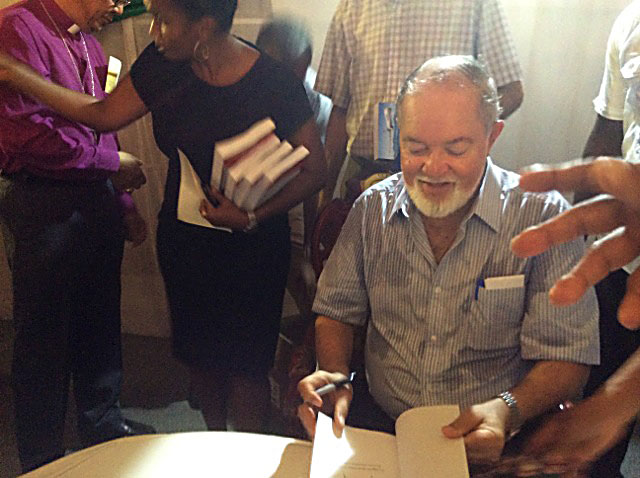 Popular: Sir James signing copies of his book at the launch party