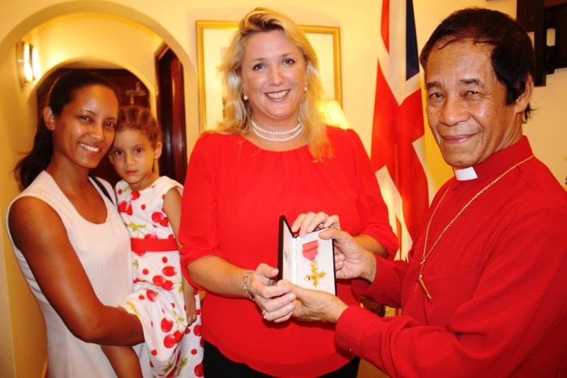 Dedication: Archbishop French and British High Commissioner Lindsay Skoll, with the Bishop's daughter and granddaughter, Frances and Shannon