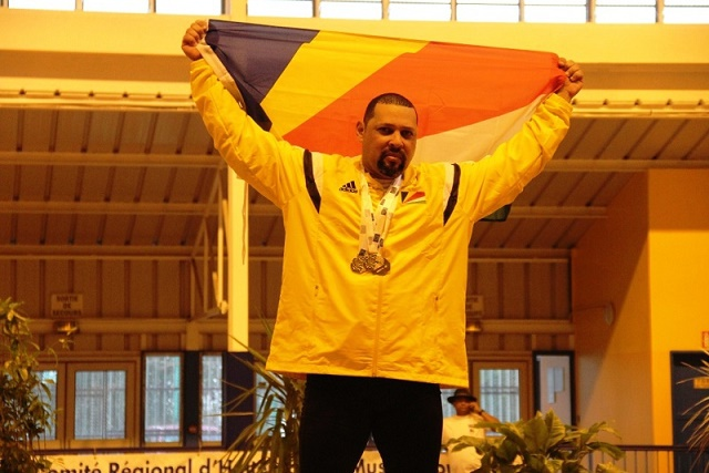 Proud: Weightlifter Steven Baccus took triple gold at the IOIG